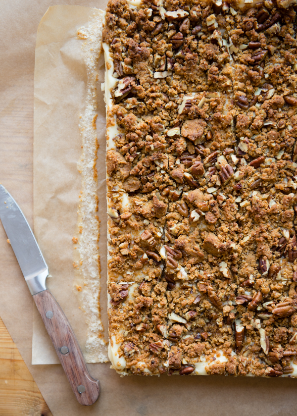 cutting-cheesecake-bars-with-pumpkin-crust-and-dulce-de-leche-swirl