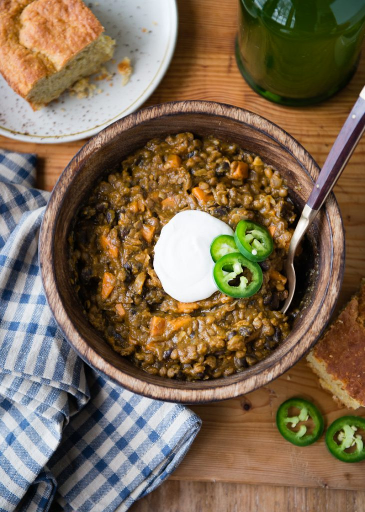 Lentil Chili with black beans, sweet potatoes, and pumpkin! It's vegan, gluten-free, and delicious!