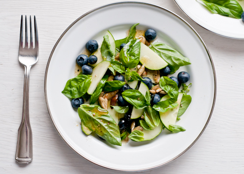 blueberries on plates sprinkle with the pepitas and drizzle with a ...